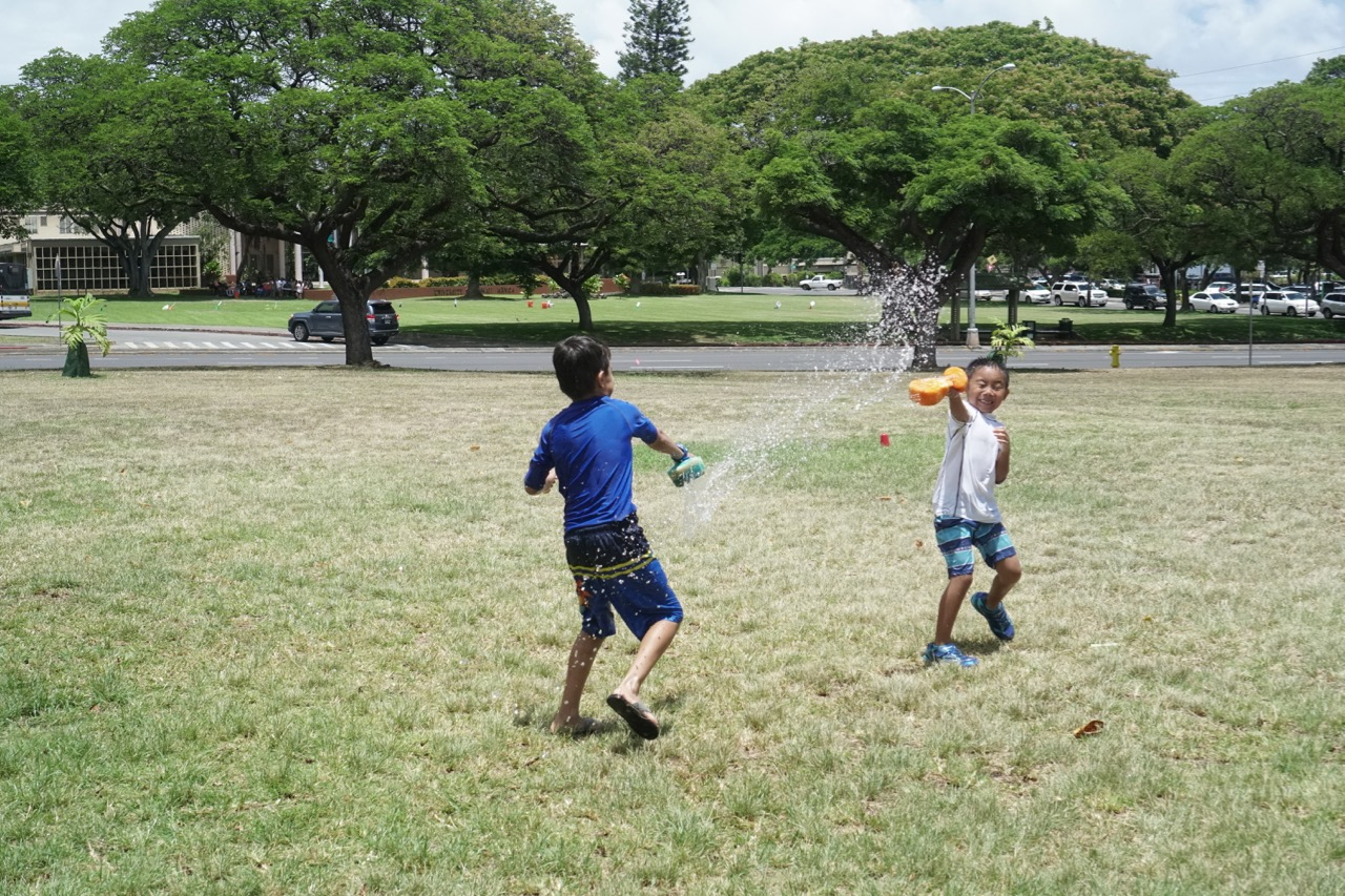 kids playing outdoors with water