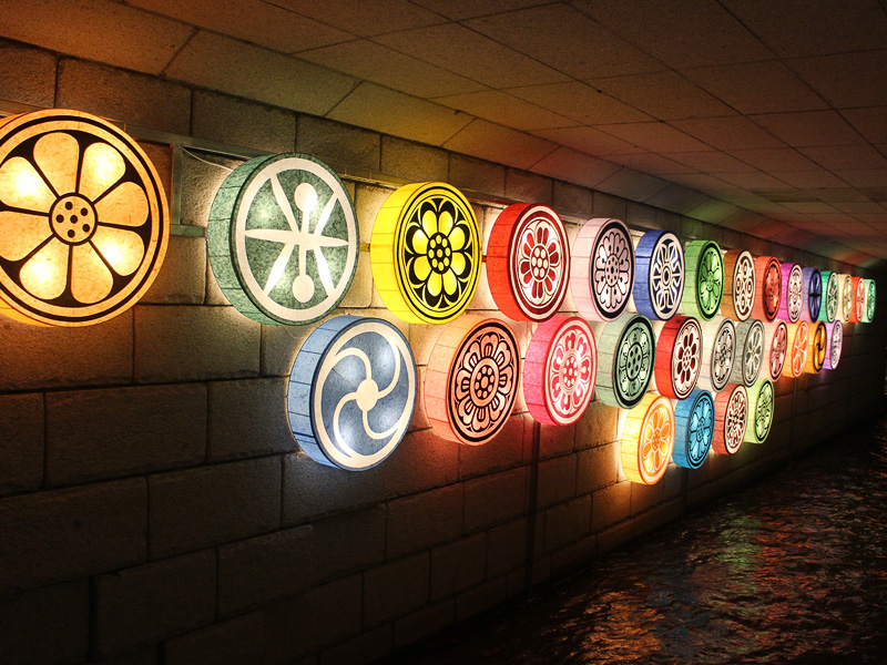 circular lighted wheels on the wall